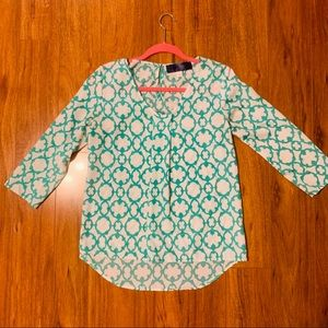 Green and white patterned blouse